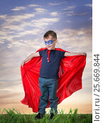 Купить «A boy in a Superman costume», фото № 25669844, снято 2 марта 2017 г. (c) Типляшина Евгения / Фотобанк Лори