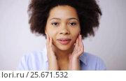 Купить «happy smiling african american young woman face», видеоролик № 25671532, снято 24 декабря 2016 г. (c) Syda Productions / Фотобанк Лори
