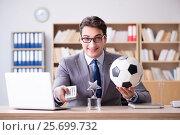 Купить «Businessman with football ball in office», фото № 25699732, снято 13 декабря 2016 г. (c) Elnur / Фотобанк Лори