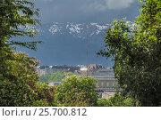 Купить «Building is near the mountains with snow», фото № 25700812, снято 2 мая 2012 г. (c) Andrey Ganysh / Фотобанк Лори