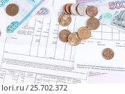 Купить «Коммунальные платежи. Квитанция и деньги», фото № 25702372, снято 21 октября 2016 г. (c) Андрей Липинский / Фотобанк Лори