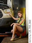 Купить «Beautiful girl mechanic repairing a car», фото № 25705360, снято 3 ноября 2016 г. (c) Воронин Владимир Сергеевич / Фотобанк Лори