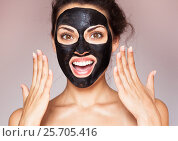 Купить «Young beautiful woman in a mask for the face of the therapeutic black mud.SPA», фото № 25705416, снято 29 июля 2015 г. (c) Екатерина Яценко / Фотобанк Лори