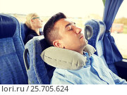 Купить «man sleeping in travel bus with cervical pillow», фото № 25705624, снято 21 октября 2015 г. (c) Syda Productions / Фотобанк Лори