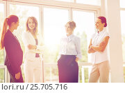 Купить «business women meeting at office and talking», фото № 25705716, снято 3 июля 2016 г. (c) Syda Productions / Фотобанк Лори