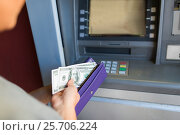 Купить «close up of hand withdrawing money at atm machine», фото № 25706224, снято 8 сентября 2016 г. (c) Syda Productions / Фотобанк Лори