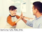 Купить «happy father and son doing high five at home», фото № 25706316, снято 24 октября 2015 г. (c) Syda Productions / Фотобанк Лори
