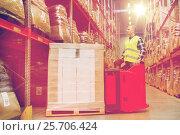 Купить «man on forklift loading cargo at warehouse», фото № 25706424, снято 9 декабря 2015 г. (c) Syda Productions / Фотобанк Лори