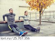 Купить «couple doing triceps dip on city street bench», фото № 25707356, снято 17 октября 2015 г. (c) Syda Productions / Фотобанк Лори