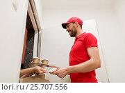 Купить «man delivering coffee and food to customer home», фото № 25707556, снято 3 декабря 2016 г. (c) Syda Productions / Фотобанк Лори