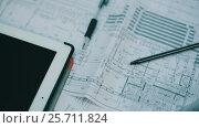 Купить «Drawings Of Constructions on a table», видеоролик № 25711824, снято 2 марта 2017 г. (c) Илья Шаматура / Фотобанк Лори