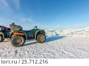 Купить «Quad bike on the ice bikala among hummocks», фото № 25712216, снято 25 февраля 2017 г. (c) Zakirov Aleksey / Фотобанк Лори