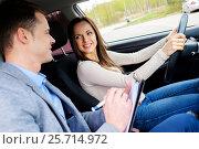 Купить «Driving instructor and woman student in examination car», фото № 25714972, снято 27 марта 2019 г. (c) Andrejs Pidjass / Фотобанк Лори