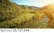Купить «UHD 4K aerial view. Low flight over fresh cold mountain river, meadow and road at sunny summer morning.», видеоролик № 25727644, снято 18 января 2017 г. (c) Александр Маркин / Фотобанк Лори
