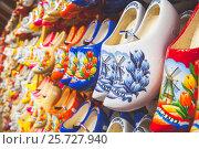 Купить «Colorful Dutch shoes made of poplar wood», фото № 25727940, снято 25 февраля 2017 г. (c) EugeneSergeev / Фотобанк Лори