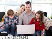 Купить «Smiling parents with children enjoying movie on laptop together», фото № 25738912, снято 23 декабря 2016 г. (c) Яков Филимонов / Фотобанк Лори