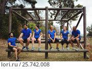 Купить «Fit people sitting on the obstacle couse», фото № 25742008, снято 24 ноября 2016 г. (c) Wavebreak Media / Фотобанк Лори