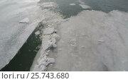 Купить «Cracked ice floating on river, aerial top view», видеоролик № 25743680, снято 14 мая 2016 г. (c) Михаил Коханчиков / Фотобанк Лори