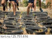 Купить «Low section of people receiving tire obstacle course training», фото № 25751616, снято 24 ноября 2016 г. (c) Wavebreak Media / Фотобанк Лори