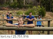 Купить «Group of people leaning on hurdles during obstacle training», фото № 25751916, снято 24 ноября 2016 г. (c) Wavebreak Media / Фотобанк Лори