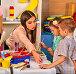 Children painting and drawing together . Craft lesson in primary school., фото № 25755744, снято 4 октября 2015 г. (c) Gennadiy Poznyakov / Фотобанк Лори