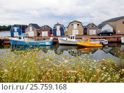 Купить «Fishing boats shacks and wharf at Stanley Bridge Prince Edward Island Canada», фото № 25759168, снято 26 августа 2010 г. (c) age Fotostock / Фотобанк Лори