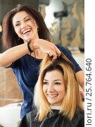 Купить «Female hairdresser and client deciding what haircut to do», фото № 25764640, снято 12 июня 2016 г. (c) Людмила Дутко / Фотобанк Лори
