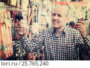 Купить «Pensioner selecting nails and hummer», фото № 25765240, снято 18 ноября 2018 г. (c) Яков Филимонов / Фотобанк Лори
