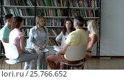 Купить «Group of young people at a meeting», видеоролик № 25766652, снято 29 июля 2016 г. (c) Raev Denis / Фотобанк Лори
