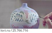 Купить «The artist paints a vase in workshop», видеоролик № 25766716, снято 7 апреля 2020 г. (c) Raev Denis / Фотобанк Лори