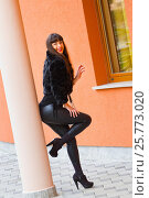 Young woman dressed in black leather and fur. Стоковое фото, фотограф Emil Pozar / age Fotostock / Фотобанк Лори
