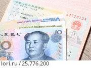Купить «Китайская виза в паспорте и деньги», эксклюзивное фото № 25776200, снято 17 марта 2017 г. (c) Яна Королёва / Фотобанк Лори