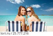 Купить «happy young women with drinks sunbathing on beach», фото № 25777216, снято 11 июля 2013 г. (c) Syda Productions / Фотобанк Лори