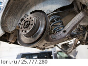 Купить «car brake disc at repair station», фото № 25777280, снято 1 июля 2016 г. (c) Syda Productions / Фотобанк Лори