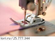 Купить «sewing machine presser foot stitching fabric», фото № 25777344, снято 29 сентября 2016 г. (c) Syda Productions / Фотобанк Лори