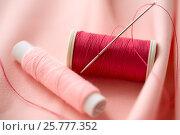 Купить «red thread spool on cloth», фото № 25777352, снято 29 сентября 2016 г. (c) Syda Productions / Фотобанк Лори