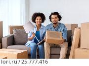 Купить «happy couple with stuff moving to new home», фото № 25777416, снято 17 декабря 2016 г. (c) Syda Productions / Фотобанк Лори