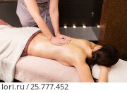 Купить «woman lying and having back massage at spa parlor», фото № 25777452, снято 26 января 2017 г. (c) Syda Productions / Фотобанк Лори
