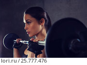 Купить «young woman flexing muscles with barbell in gym», фото № 25777476, снято 12 декабря 2015 г. (c) Syda Productions / Фотобанк Лори