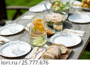table with food for dinner at summer garden party. Стоковое фото, фотограф Syda Productions / Фотобанк Лори