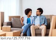 Купить «happy couple with boxes moving to new home», фото № 25777716, снято 17 декабря 2016 г. (c) Syda Productions / Фотобанк Лори