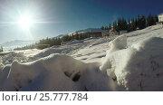 Купить «Snow snowdrifts in mountain village», видеоролик № 25777784, снято 19 февраля 2017 г. (c) Потийко Сергей / Фотобанк Лори