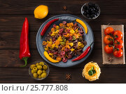 Pasta and burning peppers on a gray plate with tomatoes, sweet pepper, lemon, olives and olives on a wooden dark background. Ingredients for Italian vegetarian dishes. View from above. Стоковое фото, фотограф Татьяна Дубчук / Фотобанк Лори