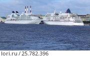 Купить «Морские круизные суда Seabourn Quest и Europa пришвартованы на набережной Лейтенанта Шмидта в Санкт-Петербурге», видеоролик № 25782396, снято 13 июля 2016 г. (c) Сергей Дубров / Фотобанк Лори