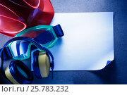 Купить «Helmet, earphones, goggles and blank paper», фото № 25783232, снято 15 февраля 2017 г. (c) Ярочкин Сергей / Фотобанк Лори