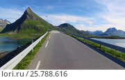 Купить «Driving a Car on a Road in Norway Lofoten», видеоролик № 25788616, снято 16 марта 2017 г. (c) Андрей Армягов / Фотобанк Лори