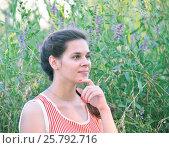 Купить «Russian girl dreams against the background of wild flowers», фото № 25792716, снято 14 июля 2016 г. (c) Володина Ольга / Фотобанк Лори