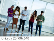 Купить «Creative business team using mobile phone in office», фото № 25796640, снято 27 ноября 2016 г. (c) Wavebreak Media / Фотобанк Лори