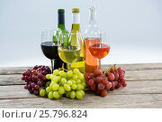 Купить «Bunches of various grapes with wine glass and bottles», фото № 25796824, снято 19 декабря 2016 г. (c) Wavebreak Media / Фотобанк Лори