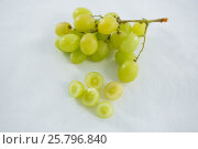 Купить «Close-up of green bunch of grapes», фото № 25796840, снято 19 декабря 2016 г. (c) Wavebreak Media / Фотобанк Лори